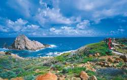 Sugarloaf Rock, Leeuwin-Naturaliste NP. People standing at a lookout.